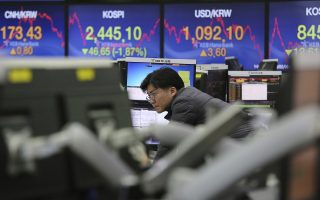 A currency trader watches monitors at the foreign exchange dealing room of the KEB Hana Bank headquarters in Seoul, South Korea, Tuesday, Feb. 6, 2018. Shares tumbled in Asia on Tuesday after a wild day for U.S. markets that resulted in the biggest drop in the Dow Jones industrial average in six and a half years. (AP Photo/Ahn Young-joon)