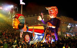 epaselect epa06537741 A float of US President Donald J. Trump and North Korea's leader Kim Jong Un entitled 'US Space Programme / North Korea' goes through the crowd during the Nice carnival parade, in Nice, France, 17 February 2018. The 134th annual Carnival of Nice will run from 17 February to 03 March. The theme will be 'King of Space'.  EPA/SEBASTIEN NOGIER