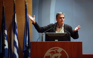 Ο υπουργός Οικονιμικών, Ευκλείδης Τσακαλώτος, μιλάει σε ανοικτή εκδήλωση-συζήτηση που διοργάνωσε η Νομαρχιακή Επιτροπή του ΣΥΡΙΖΑ Α' Αθήνας με θέμα: «Προς νέα εποχή;», τη Δευτέρα 12 Φεβρουαρίου 2018, στο κτίριο του ΕΒΕΑ. ΑΛΕΞΑΝΔΡΟΣ ΜΠΕΛΤΕΣ