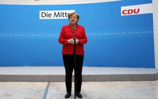 Η Γερμανίδα καγκελάριος κατά τη διάρκεια των χθεσινών δηλώσεών της στα κεντρικά γραφεία του κόμματός της.