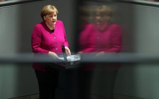 epa06617809 German Chancellor Angela Merkel delivers a speech to the German Bundestag in Berlin, Germany, 21 March 2018. Merkel, in her government declaration, spoke about the upcoming new German government's work.  EPA/FELIPE TRUEBA