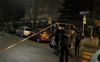 Police stand in front of the Iranian ambassador's residence after an attack in Vienna, Austria, Monday, March 12, 2018. Police say an Austrian attacker was shot and killed by the guard he wounded outside the residence. (AP Photo/Ronald Zak)