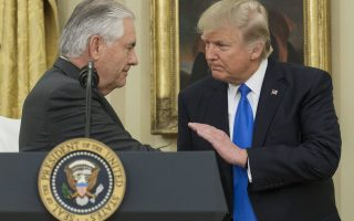 epa05765718 US President Donald J. Trump (R) shakes hands with Rex Tillerson (L) after Tillerson was sworn-in as Secretary of State, in the Oval Office of the White House in Washington, DC, USA, 01 February 2017. Tillerson was confirmed by the Senate, on 01 February, in a 56-to-43 vote to become the nation's 69th Secretary of State.  EPA/MICHAEL REYNOLDS / POOL