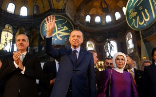 Turkish President Tayyip Erdogan, accompanied by his wife Emine Erdogan and Culture and Tourism Minister Numan Kurtulmus, attends opening ceremony of Yeditepe Biennial at the Byzantine-era monument of Hagia Sophia, known as Ayasofya which is now a museum, in Istanbul, Turkey March 31, 2018. Kayhan Ozer/Presidential Palace/Handout via REUTERS ATTENTION EDITORS - THIS PICTURE WAS PROVIDED BY A THIRD PARTY. NO RESALES. NO ARCHIVE.