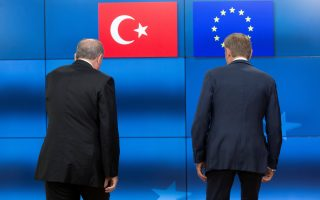 FILE PHOTO: Turkish President Recep Tayyip Erdogan (L) stands with European Council President Donald Tusk before a meeting at the European Council in Brussels, Belgium, May 25, 2017. REUTERS/Olivier Hoslet/Pool/File Photo