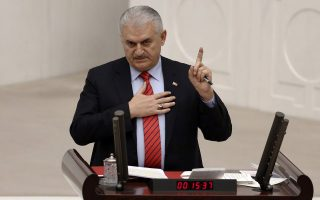 epa05708735 A picture made available on 10 January 2017 shows Turkish Prime Minister Binali Yildirim speaking at the Turkish parliament in Ankara, Turkey, 09 January 2017. Turkish parliament will begin debating a reform of the constitution to change the country's parliamentarian system of governance into a presidential one, which the opposition denounced as giving more power to Turkish president Recep Tayyip Erdogan.  EPA/TUMAY BERKIN