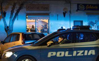epa06472874 Members of the Italian Police force conduct an anti-mafia operation against the Spada clan in Ostia, a coastal town near Rome, Italy, 25 January 2018. According to reports, 32 people were arrested, including Carmine Spada, the chief of the clan. Among the detainees there is also the clan's boss brother, Roberto, who attacked a RAI State broadcaster TV crew last November, media added.  EPA/MASSIMO PERCOSSI