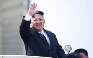 epa05908579 North Korean leader Kim Jong-un waves from a balcony during a parade for the 'Day of the Sun' festival on Kim Il-Sung Square in Pyongyang, North Korea, 15 April 2017. North Koreans celebrate the 'Day of the Sun' festival commemorating the 105th birthday anniversary of former supreme leader Kim Il-sung on 15 April as tension over nuclear issues rise in the region.  EPA/HOW HWEE YOUNG