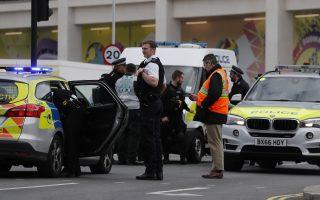 British police respond to an incident at Westfield shopping center in London, Friday, March 23, 2018, one of the largest shopping malls in Europe.  Two nearby subway stations were briefly closed and roads closed while a vehicle in the mall parking lot was checked.  (AP Photo/Frank Augstein)