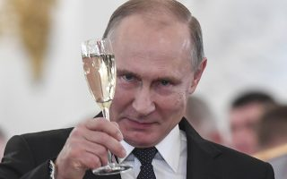 Russian President Vladimir Putin makes a toast during an award ceremony in the Kremlin, in Moscow, Russia, Thursday, Dec. 28, 2017, for Russian Armed Forces service personnel who took part in the anti-terrorist operation in Syria. Putin said at Thursday's award ceremony that Wednesday's explosion at a supermarket in the country's second-largest city was a terrorist attack. (Kirill Kudryavtsev/Pool Photo via AP)
