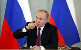 epa06607861 Russian President Vladimir Putin speaks during a meeting with medical specialists in the Almazov's National Medical Center in St. Petersburg, Russia 16 March 2018. National Medical Research Center of V.A. Almazov is Russia's largest multidisciplinary center, employing more than seven thousand employees and training more than two thousand medical specialists. The Almazov's Center ranks first among the scientific organizations of the Ministry of Health of Russia. The clinic of the center annually receives 170 thousand outpatients, 36 thousand patients in the hospital, about 18 thousand surgeries are performed annually.  EPA/ANATOLY MALTSEV / POOL