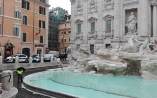 epa06634455 (FILE) - An employee engaged in the collection of coins thrown according to tradition by tourists in the Trevi Fountain and intended for Caritas, Rome, Italy, 04 January 2016 (issued 28 March 2018). Italian media on 28 March 2018 report of plans to hand over the collected coins to the city of Rome, instead of giving them to the charitable organization Caritas.  EPA/ROBERTA MARROLLO
