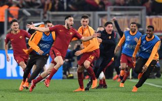 epaselect epa06660299 Roma's Kostas Manolas (3-L) celebrates with  teammates after scoring the 3-0 goal during the UEFA Champions League quarter final second leg match between AS Roma and FC Barcelona at Olimpico stadium in Rome, Italy, 10 April 2018.  EPA/ETTORE FERRARI