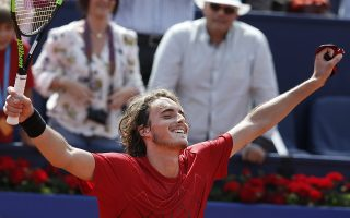 Stefanos Tsitsipas of Greece celebrates defeating Spain's Pablo Carreno Busta in two sets 7-5, 6-3, in his semifinal match against of the Barcelona Open Tennis Tournament in Barcelona, Spain, Saturday, April 28, 2018. (AP Photo/Manu Fernandez)