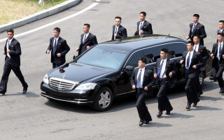 epaselect epa06695900 North Korean leader Kim Jong-un, riding in a sedan, returns to the northern side of the truce village of Panmunjom for lunch after holding talks with South Korean President Moon Jae-in at the Peace House on the southern side of the truce village of Panmunjom, 27 April 2018. Kim will return to the Peace House again after lunch for additional talks and other events with Moon.  EPA/YONHAP SOUTH KOREA OUT