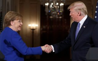 President Donald Trump shakes hands with German Chancellor Angela Merkel at the end of their news conference in the East Room of the White House, Friday, April 27, 2018, in Washington. Donald Trump and Emmanual Macron? Judging from the body language, mon ami! The president and Germany's Angela Merkel? Ach, not so chummy. (AP Photo/Evan Vucci)