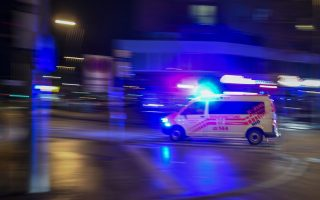 epa06587956 An ambulance with emergency lights switched on at the Praterstrasse in Vienna, Austria, 07 March 2018. According to local media reports, a family of three people have been seriously injured in a knife attack near the Prater park earlier this evening. The motive of the attack is unknown and the police is still searching for the attacker.  EPA/CHRISTIAN BRUNA