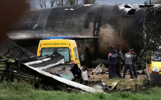 epa06661698 Algerian rescuers stand next to the wreckage of a military transport aircraft that crashed in Boufarik, about 30Kms south the capital Algiers, Algeria, 11 April 2018. Reports state at least 257 people were killed after an Algerian military transport aircraft crashed shortly after taking off from Boufarik military airfield outside the capital Algiers.  EPA/STR