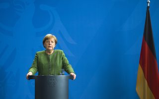 German Chancellor Angela Merkel attends a statement with Serbia's President Aleksandar Vucic prior to a meeting at the chancellery in Berlin, Germany, Friday, April 13, 2018. (AP Photo/Markus Schreiber)