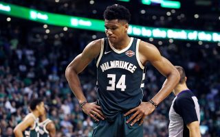 Milwaukee Bucks forward Giannis Antetokounmpo pauses after a basket by Boston Celtics guard Terry Rozier during the fourth quarter of Game 7 of an NBA basketball first-round playoff series in Boston, Saturday, April 28, 2018. The Celtics won 112-96, eliminating the Bucks from the playoffs. (AP Photo/Charles Krupa)