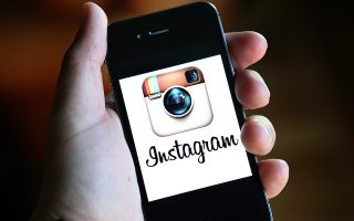 FAIRFAX, CA - DECEMBER 18: The Instagram logo is displayed on an Apple iPhone on December 18, 2012 in Fairfax, California. Users of the popular photo-sharing app Instagram are angered over language in Instagram's new terms of service that states that a business may use any of the users photographs in advertising without compensation to the user. The policy is set to go into effect on January 16, 2013.   Justin Sullivan/Getty Images/AFP== FOR NEWSPAPERS, INTERNET, TELCOS & TELEVISION USE ONLY ==