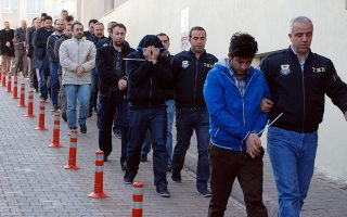 epa05928674 Members of the Turkish police escort suspects of the Gulen movement during nationwide operations, in Kayseri city, Turkey, 26 April 2017. According to reports on 26 April 2017, Turkey has conducted raids across the country, one of the largest operations in months, arresting over 800 people suspected of being connected to the movement loyal to US-based Islamic cleric Fethullah Gulen that lead to a failed coup in July 2016.  EPA/OLCAY DUZGUN TURKEY OUT