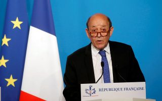 French Minister for Foreign Affairs Jean-Yves Le Drian makes an official statement with French Minister of the Armed Forces Florence Parly (not pictured) in the press room at the Elysee Palace, in Paris, France, April 14, 2018. The French military on Saturday targeted Syria's main chemicals research centre as well as two other facilities, hours after President Emmanuel Macron ordered a military intervention in Syria alongside the United States and Britain in an attack on the chemical weapons arsenal.  Michel Euler/Pool via Reuters