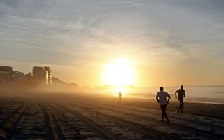epa04141463 Picture taken on 05 December 2012 shows a general view of people jogging along Ipanema beach at sunrise in Rio de Janeiro, Brazil. Rio de Janeiro is one of the host cities of the FIFA World Cup 2014 hosting four matches in the tournament's group phase, one round of 16, one quarter final and the final match on 13 July 2014. The 20th FIFA World Cup will take place in Brazil from 12 June to 13 July 2014.  EPA/GERNOT HENSEL