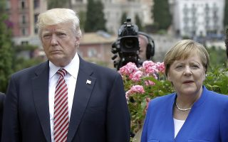 US President Donald Trump is flanked by German Chancellor Angela Merkel during the G7 meeting in Taormina, Italy, Friday, May 26, 2017. President Donald Trump keeps criticizing Germany's trade surplus with the United States. Germans respond by saying their products are just better and people want to buy them. (AP Photo/Luca Bruno)