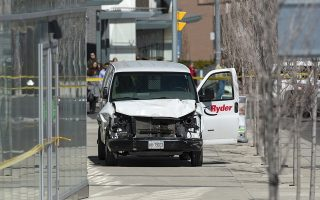 epa06687913 A rented van sits on a sidewalk about a mile from where several pedestrians were injured in northern Toronto, Canada, 23 April 2018. Eight to ten people were struck in two locations. Police took the driver into custody.  EPA/WARREN TODA