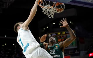 epa06692568 Real Madrid's Slovenian point guard Luka Doncic (L) vies for the ball with Panathinaikos' US center Kenny Gabriel (R) during the basketball Euroleague playoff match between Real Madrid and Panathinaikos Athens at WiZink Center, in Madrid, Spain, 25 April 2018.  EPA/JUANJO MARTIN
