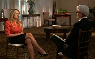 This image released by CBS News shows Stormy Daniels, left, during an interview with Anderson Cooper which will air on Sunday, March 25, 2018, on