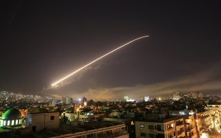 Damascus sky lights up with service to air missile fire as the U.S. launches an attack on Syria targeting different parts of the Syrian capital Damascus, Syria, early Saturday, April 14, 2018. Syria's capital has been rocked by loud explosions that lit up the sky with heavy smoke as U.S. President Donald Trump announced airstrikes in retaliation for the country's alleged use of chemical weapons. (AP Photo/Hassan Ammar)