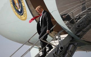 President Donald Trump walks down the stairs of Air Force One during his arrival at Palm Beach International Airport, in West Palm Beach, Fla.,Thursday, March 29, 2018. Trump is spending the weekend at his his Mar-a-Lago estate. (AP Photo/Pablo Martinez Monsivais)