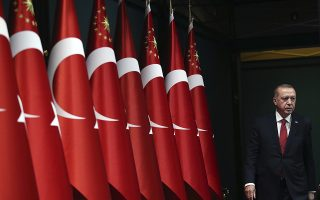 FILE - In this Wednesday, April 18, 2018 file photo, Turkey's President Recep Tayyip Erdogan walks before announcing early presidential and parliamentary elections, at the Presidential Palace, in Ankara, Turkey. Turkey's weak opposition is scrambling to try and mount a strong challenge against strongman President Erdogan with just nine weeks to prepare for snap elections, scheduled for June 24, 2018. Turkey is switching from a parliamentary system to an executive presidential system that will concentrate increased powers in the hands of the president, following a narrowly approved referendum last year. (Pool Photo via AP, File)