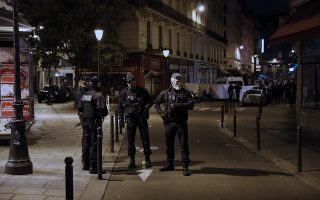 epa06732219 French police stand guard next to the place where a man attacked and stabbed several people in Paris, France, 12 May 2018. According to the latest reports, two persons are dead including the attacker, several were injured.  EPA/ETIENNE LAURENT