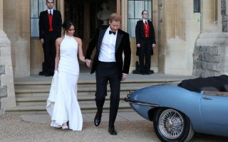 The newly married Duke and Duchess of Sussex, Meghan Markle and Prince Harry, leaving Windsor Castle after their wedding to attend an evening reception at Frogmore House, hosted by the Prince of Wales Windsor, Britain, May 19, 2018.  Steve Parsons/Pool via REUTERS