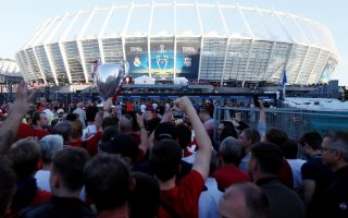 Soccer Football - Champions League Final - Real Madrid v Liverpool - Kiev, Ukraine - May 26, 2018   Liverpool fans make their way to the stadium before the match   REUTERS/Valentyn Ogirenko
