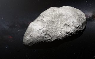 This artist's impression shows the exiled asteroid 2004 EW95, the first carbon-rich asteroid confirmed to exist in the Kuiper Belt and a relic of the primordial Solar System. This curious object likely formed in the asteroid belt between Mars and Jupiter and must have been transported billions of kilometres from its origin to its current home in the Kuiper Belt.