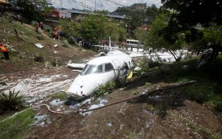 A Gulfstream G200 aircraft is seen after it skidded off the runway during landing at Toncontin International Airport in Tegucigalpa, Honduras May 22, 2018. REUTERS/Jorge Cabrera