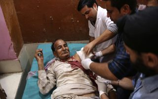 Doctors treat a man injured in India-Pakistan cross-border firing, at a hospital in Ranbir Singh Pura, India, Tuesday, May 22, 2018. (AP Photo/Channi Anand)