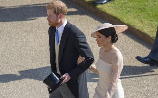 Meghan, the Duchess of Sussex walks with her husband Prince Harry during a garden party at Buckingham Palace in London, Tuesday May 22, 2018. The event is part of the celebrations to mark the 70th birthday of Prince Charles and their first royal engagement as a married couple. (Ian Vogler/Pool Photo via AP)