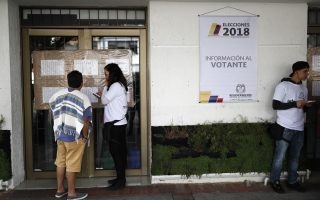 Voters look at electoral lists at a polling station as Colombians vote for a new president in Bogota, Colombia, May 27, 2018. REUTERS/Carlos Garcia Rawlins