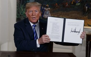 President Donald Trump shows a signed Presidential Memorandum after delivering a statement on the Iran nuclear deal from the Diplomatic Reception Room of the White House, Tuesday, May 8, 2018, in Washington. Trump announced the U.S. will pull out of the landmark nuclear accord with Iran, dealing a profound blow to U.S. allies and potentially deepening the president's isolation on the world stage.  (AP Photo/Evan Vucci)