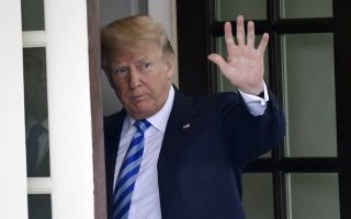 FILE - In this Wednesday, May 16, 2018, file photo, U.S. President Donald Trump waves from the White House, in Washington. In a series of tweets Sunday, May 20, 2018, Trump skims over the facts involving the investigations into Russian meddling in the 2016 election. (AP Photo/Susan Walsh, File)