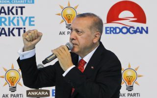 Turkey's President Recep Tayyip Erdogan delivers a speech to supporters of his ruling Justice and Development (AKP) Party, to outline his plans for after the elections and present MP candidates, in a rally in Ankara, Turkey, Thursday, May 24, 2018. Turkey will hold parliamentary and presidential elections on June 24, 2018, seen as important as it will transform Turkey's governing system to an executive presidency. (AP Photo/Burhan Ozbilici)