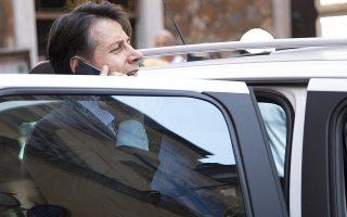 epa06764213 Italian Premier designate, Giuseppe Conte, leaves his house in Rome, Italy, 26 May 2018. Conte will go to the Lower House.  EPA/MAURIZIO BRAMBATTI