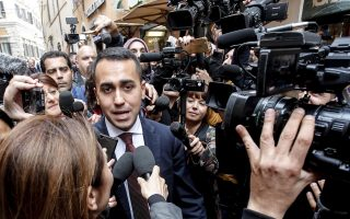 epa06741655 Italy's Five-Star Movement (M5S) leader Luigi Di Maio (C-L) is surrounded by the media as he leaves the parliament's Lower House in Rome, Italy, 16 May 2018. Luigi Di Maio said that he and 'League' party chief Matteo Salvini were willing to be outside the government team if this was necessary to make a M5S-League executive possible. 'I hope that I can be involved in the government to put myself personally to the test, but if necessary, I and Salvini are ready to be outside,' Di Maio told reporters.  EPA/GIUSEPPE LAMI