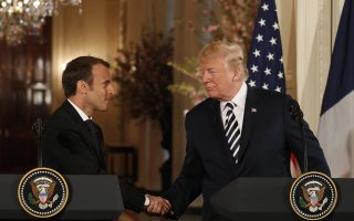 epa06689710 US President Donald J. Trump (R) and French President Emmanuel Macron (L) during a joint press conference at the White House in Washington, DC, USA, 24 April 2018. President Macron will be in DC for three days for a state visit at the White House and an address to a joint session of Congress on 25 April.  EPA/SHAWN THEW