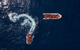 Refugees and migrants are rescued by members of the Spanish NGO Proactiva Open Arms, after leaving Libya trying to reach European soil aboard an overcrowded rubber boat, north of Libyan coast, Sunday, May 6, 2018.  In total 105 refugees and migrants from various countries, including Bangladesh, Egypt, Nigeria, Marrocos, Gana, Pakistan, Sudan, Libya, Eritrea and Senegal, were rescued in the overcrowded rubber boat. (AP Photo/Felipe Dana)